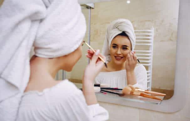 woman-smiling-morning-mirror